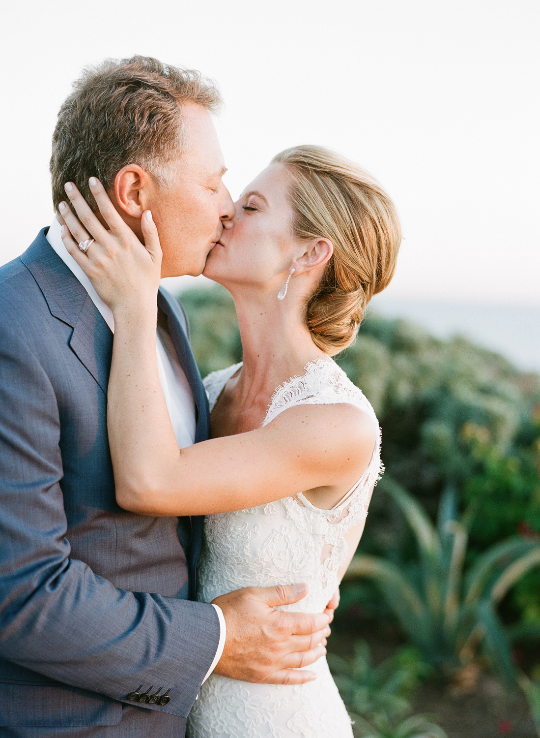 Margo kisses her groom during a couple session with Sylvie Gil at their Laguna Beach wedding reception