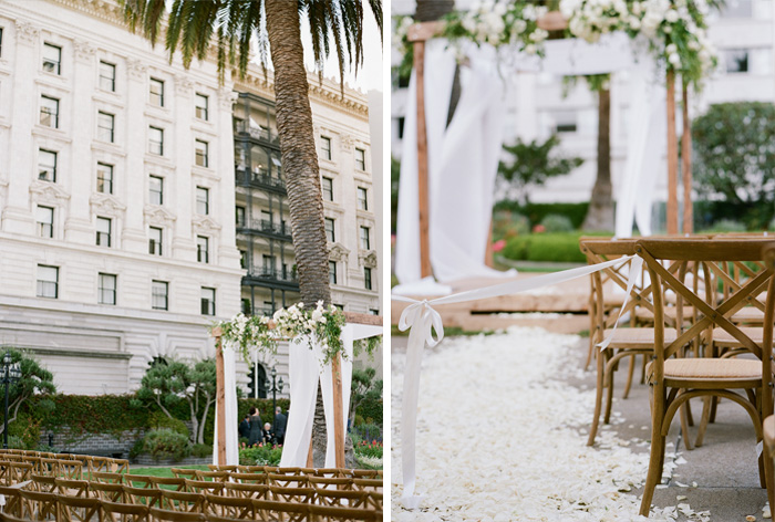 The gorgeous rooftop ceremony space at the San Francisco Fairmont, adorned with white florals and a rustic wooden arbor; photo by Sylvie Gil