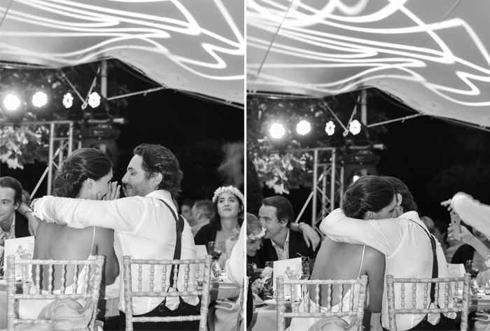 Amelie & Laurent share happy tears and a sweet embrace at the outdoor wedding reception; photos by Sylvie Gil