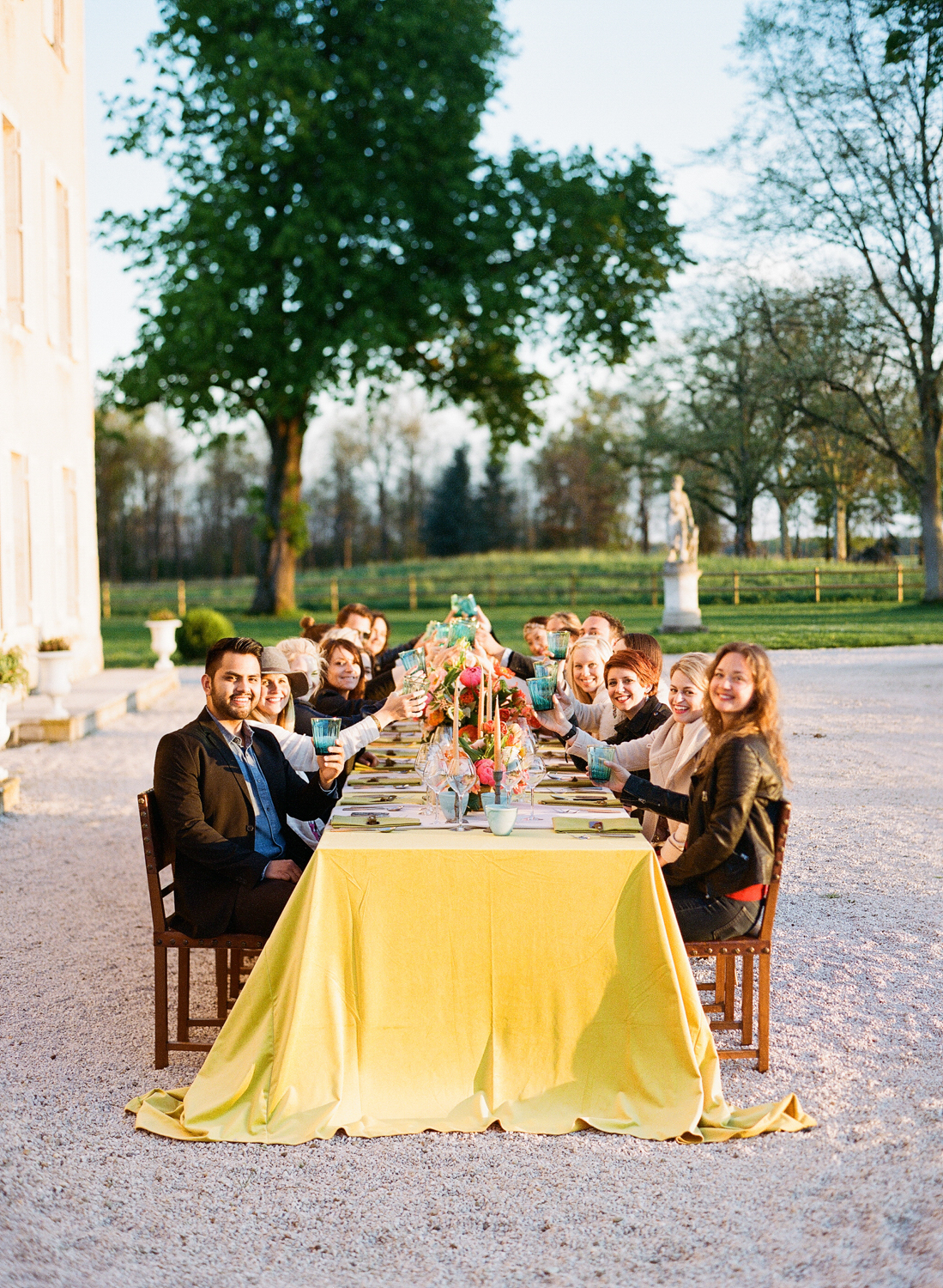 Sylvie Gil Workshop 2016 attendees enjoying a sunset dinner at the beautifully set jewel-toned reception table; photo by Sylvie Gil