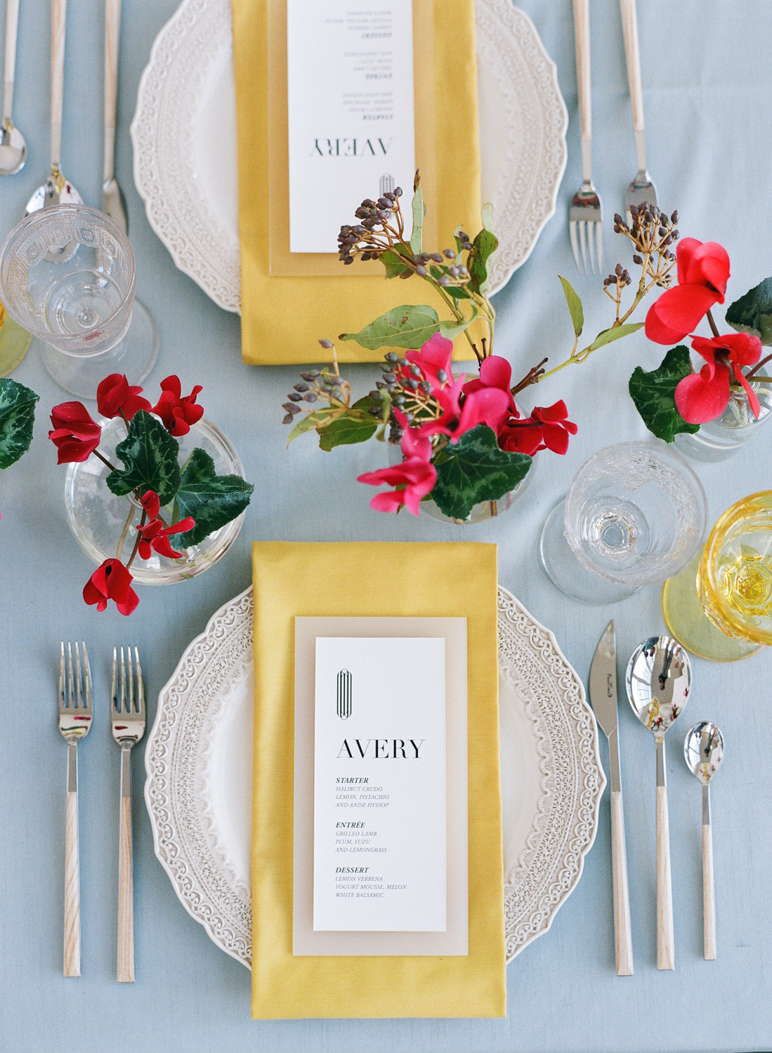 Simple colorful place settings, begonia floral accents; Sylvie Gil Photography