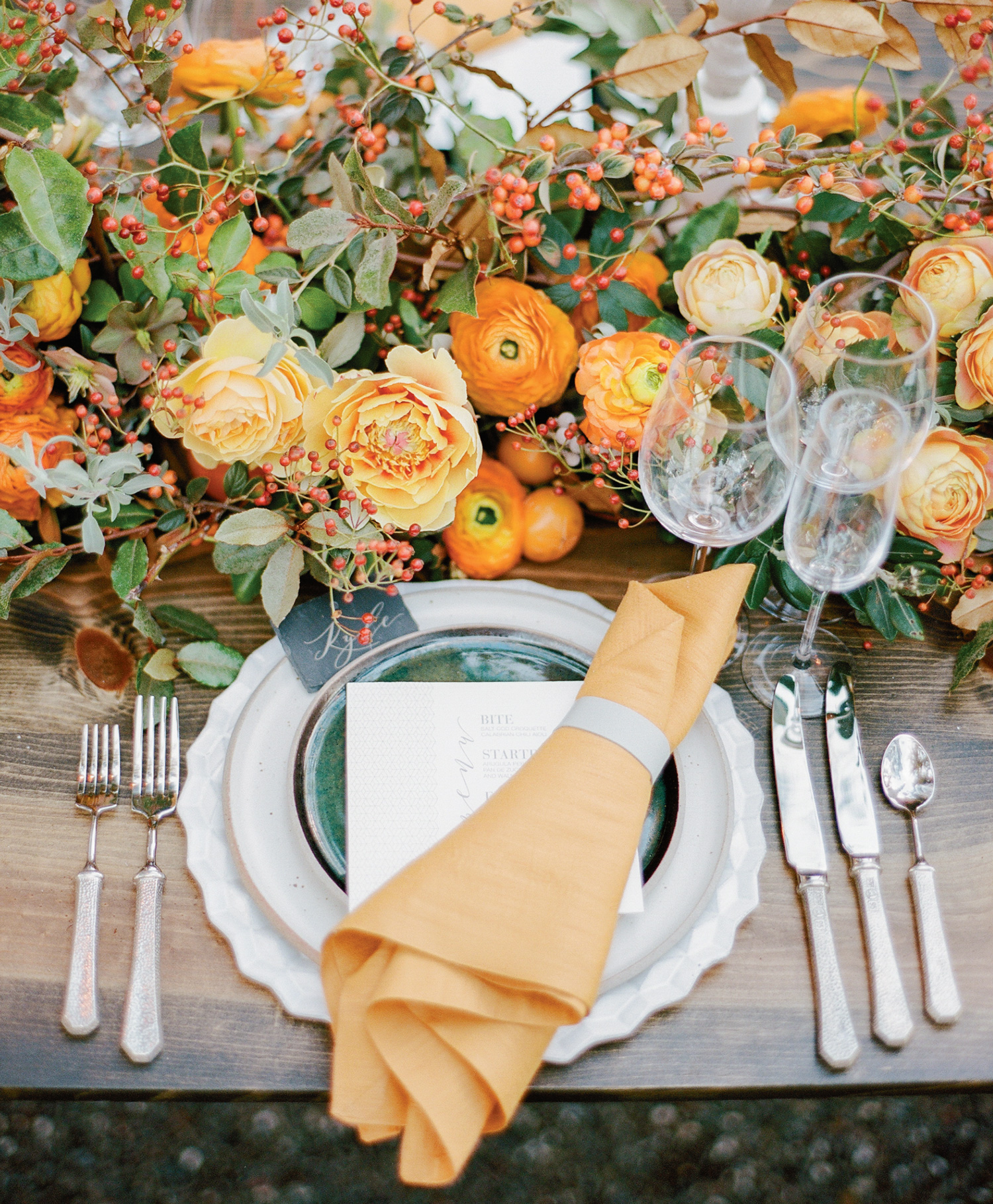 Persimmon color palette table setting and Max Gill floral garland; Sylvie Gil Photography