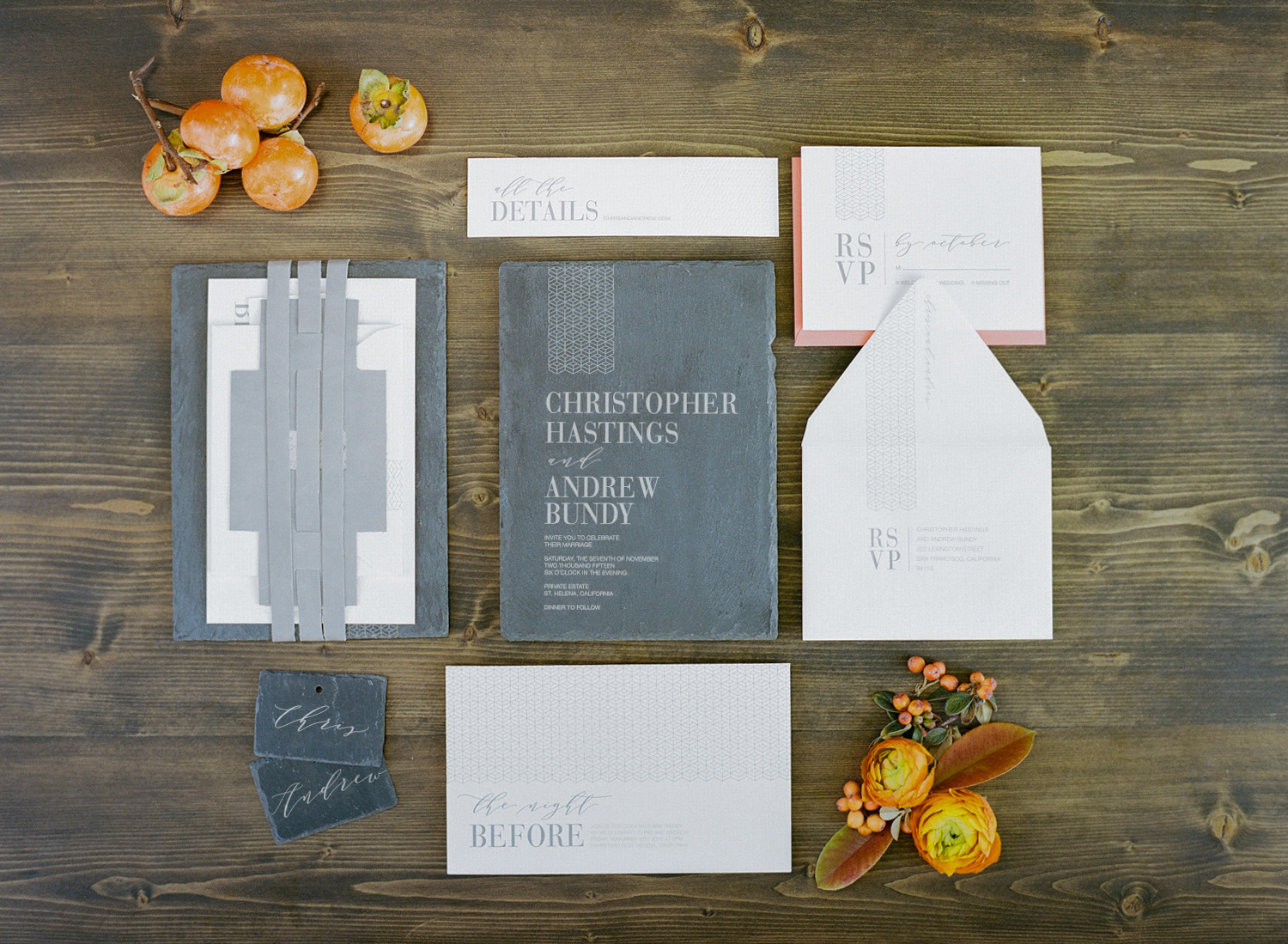 Slate grey invitation suite with persimmon orange highlights; Sylvie Gil Photography