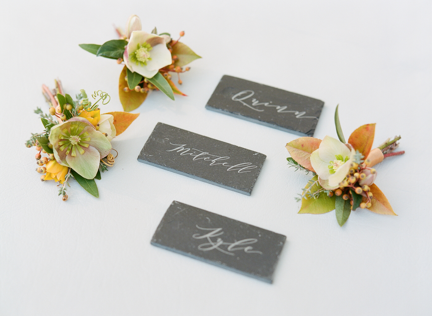 Slate reception table placecards and delicate autumn boutonnieres; Sylvie Gil Photography