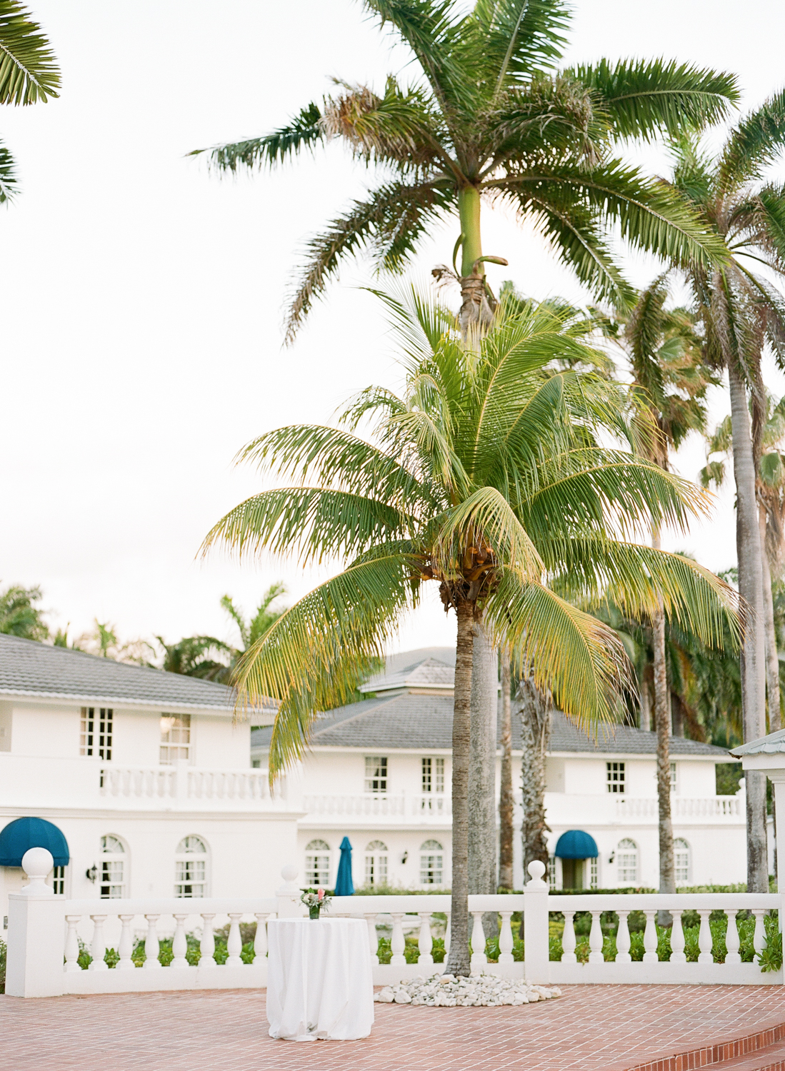 Whitewashed island buildings, outdoor hotel patio reception space; Sylvie Gil Photography