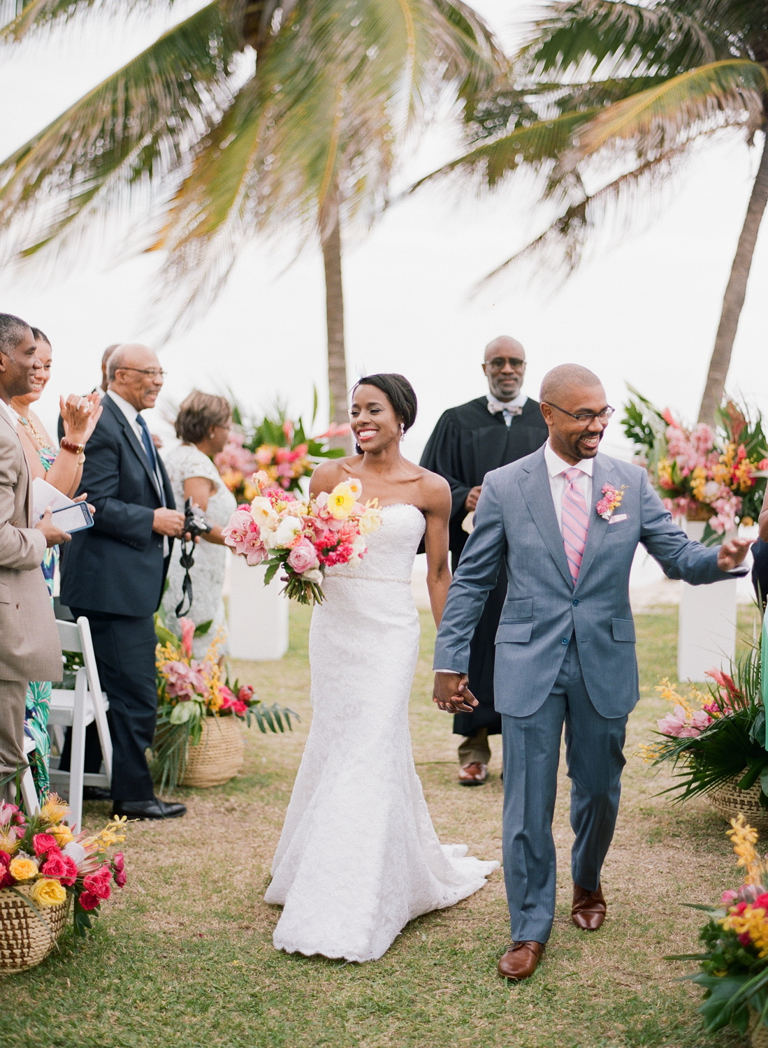 Bride and groom walk down the aisle just married in Montego Bay, Jamaica; Sylvie Gil Photography