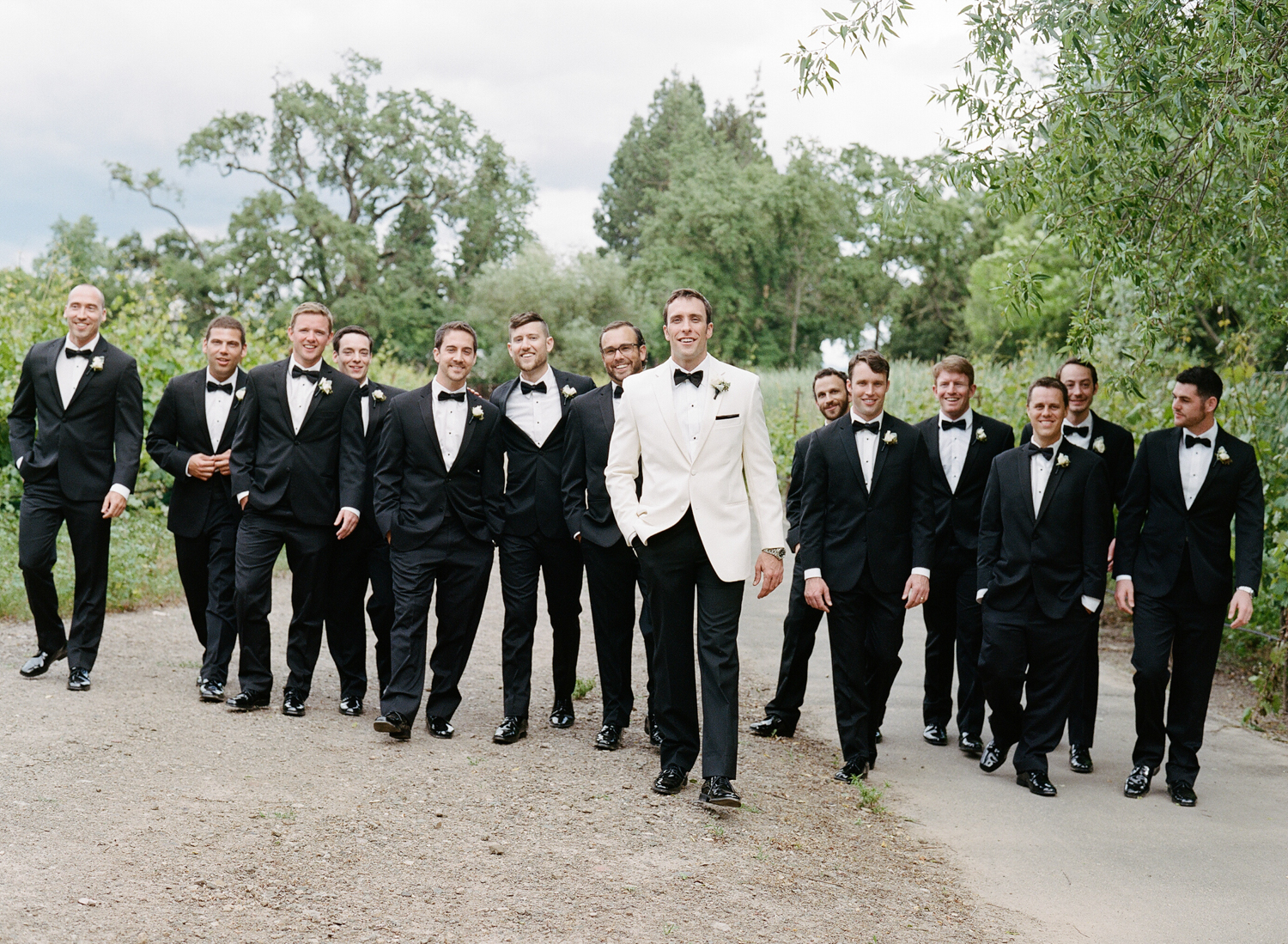 Groom with his groomsmen in Napa Valley before the wedding at Vintage Estates; Sylvie Gil Photography