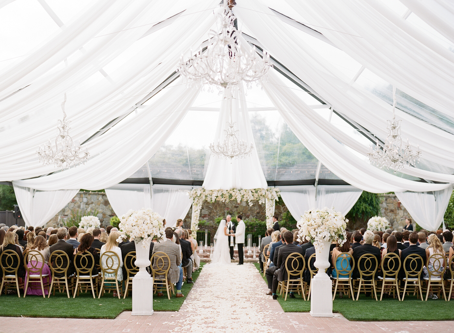 Bride and groom exchanging vows under an awning at Vintage Estates, Yountville, CA; Sylvie Gil Photography
