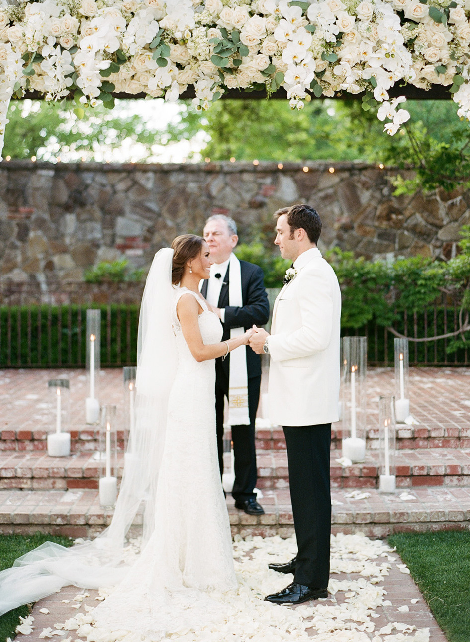 Bride and groom holding hands during wedding ceremony at Vintage Estates, Yountville; Sylvie Gil Photography