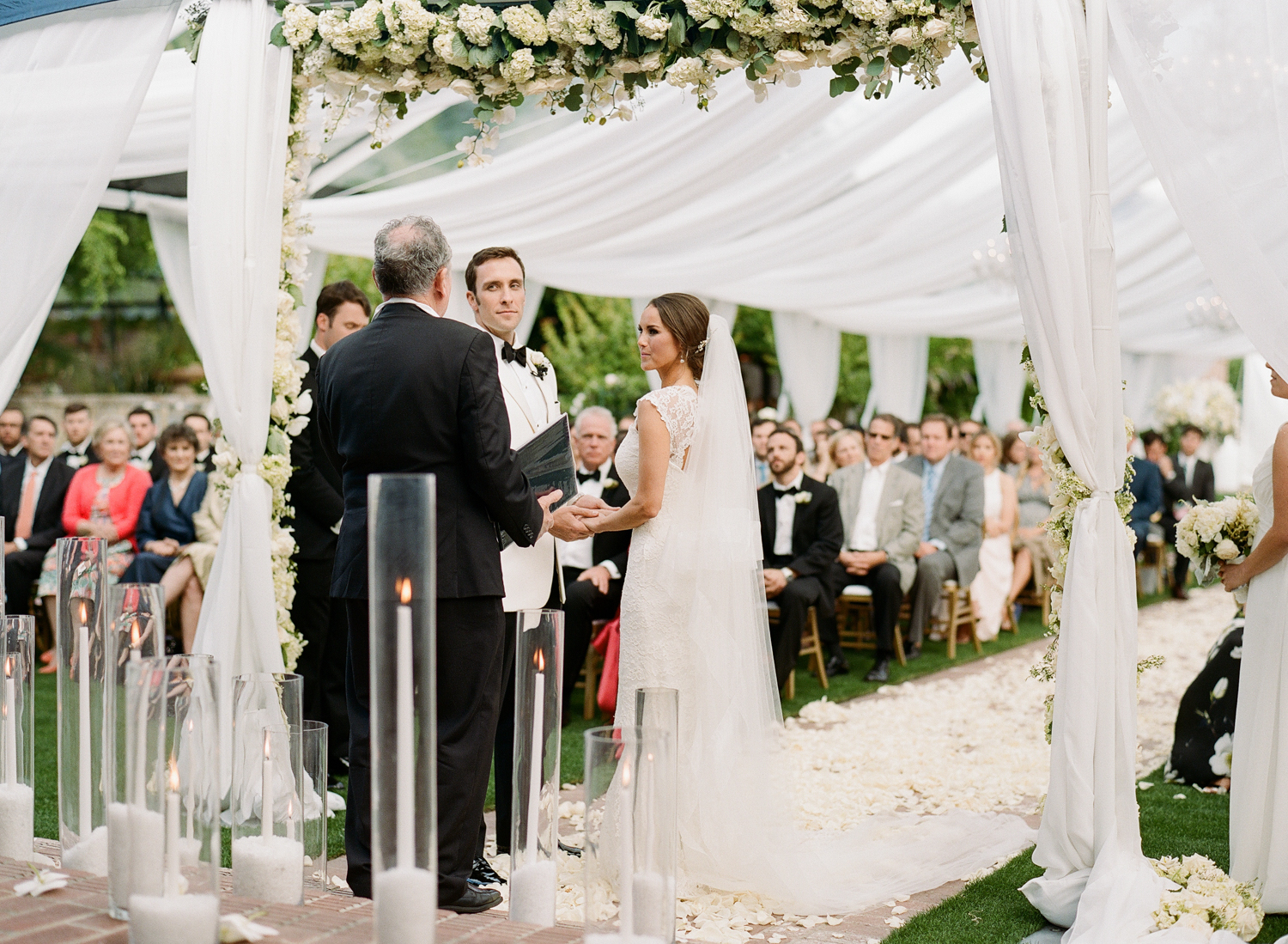 Bride and groom surrounded by family during wedding ceremony at Vintage Estates, Yountville; Sylvie Gil Photography