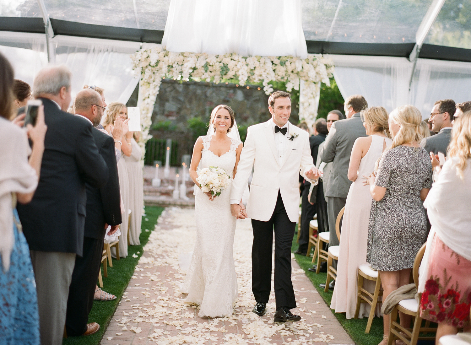 Bride and groom walk up the aisle, just married after ceremony at Vintage Estates; Sylvie Gil Photography