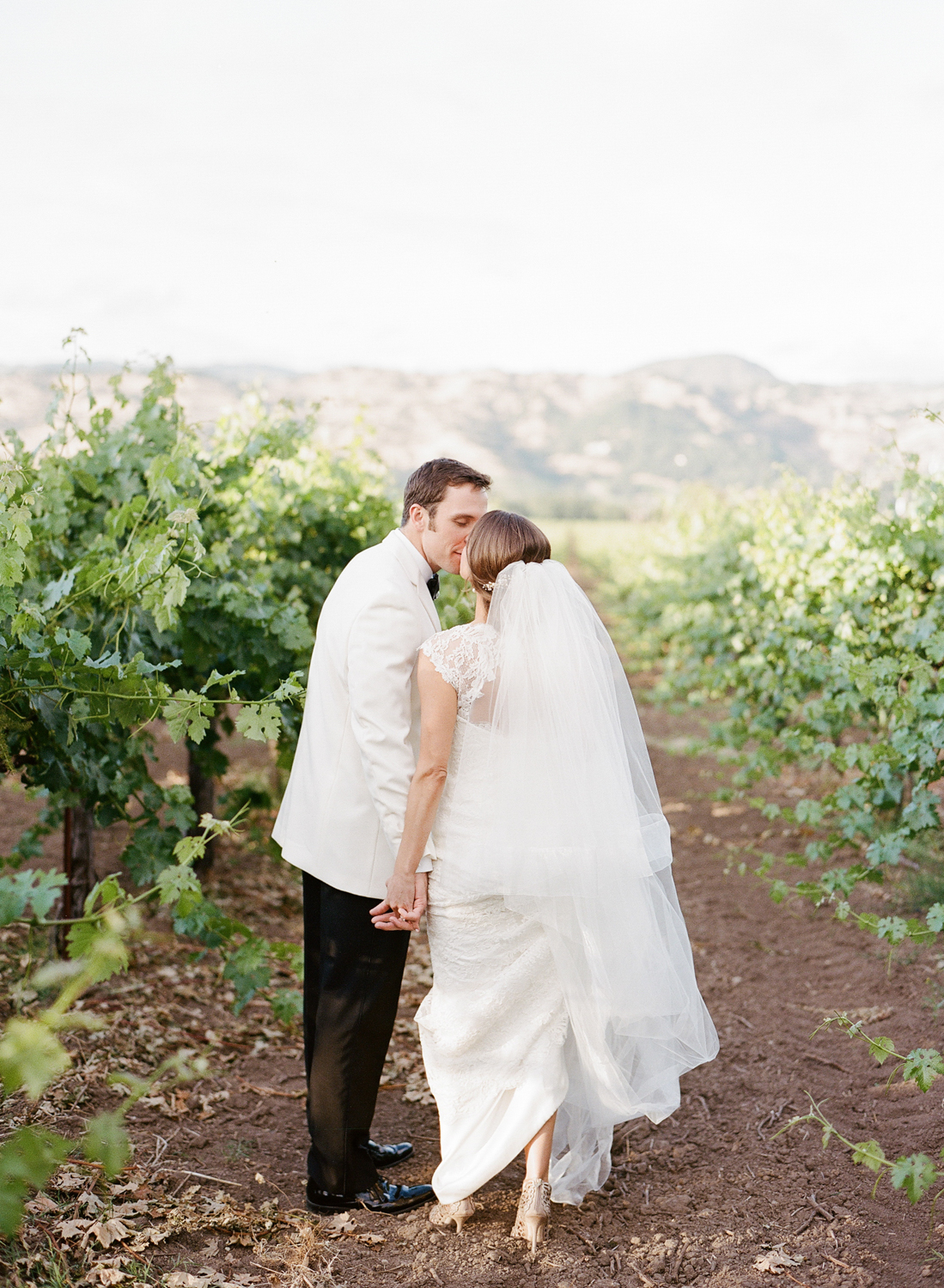 Just married couple session after the wedding in vineyards of Yountville, CA; Sylvie Gil Photography