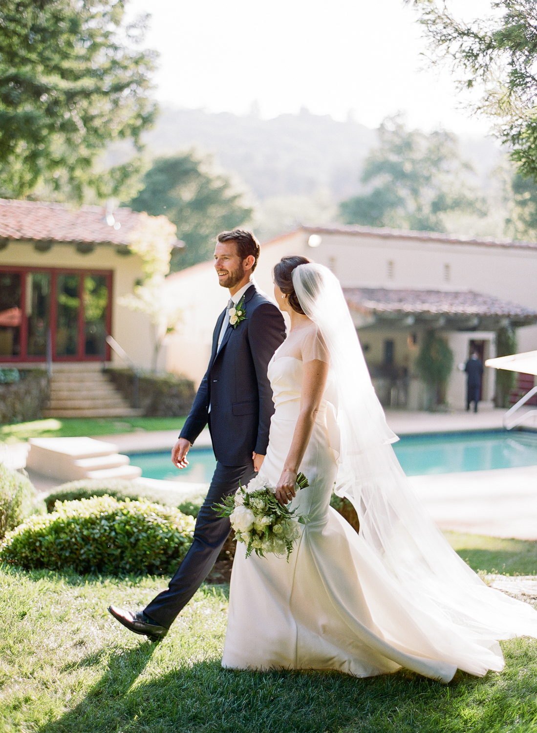 Bride and groom walk out of the ceremony, just married; Sylvie Gil Photography