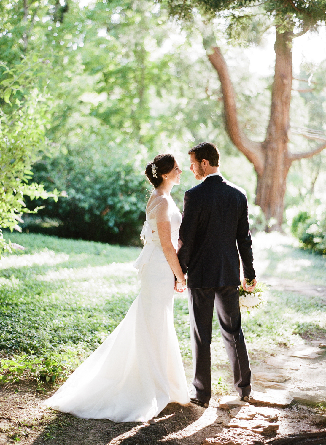 The bride and groom share a moment just married; Sylvie Gil Photography