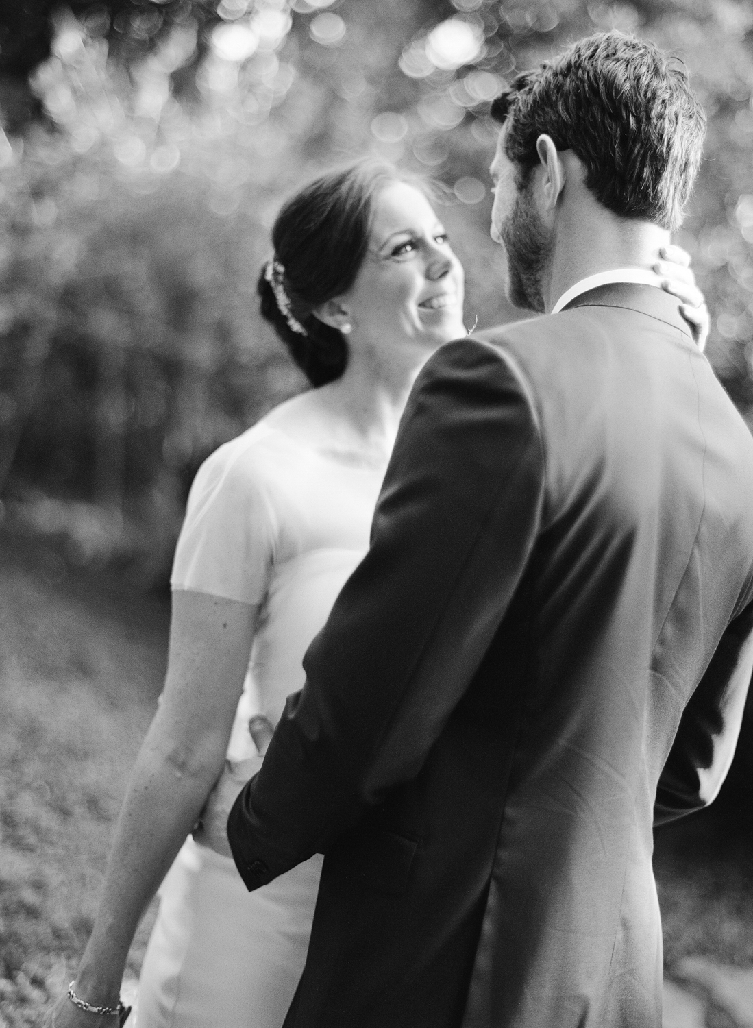 Bride and groom just married, bride wearing a modern Vera Wang wedding gown; Sylvie Gil Photography