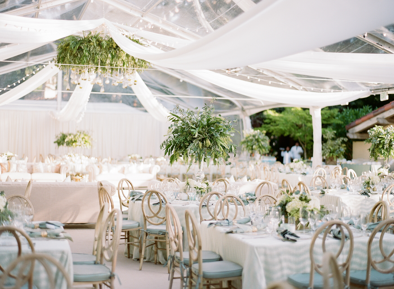 Awnings and string lights draped through the reception tent; Sylvie Gil Photography