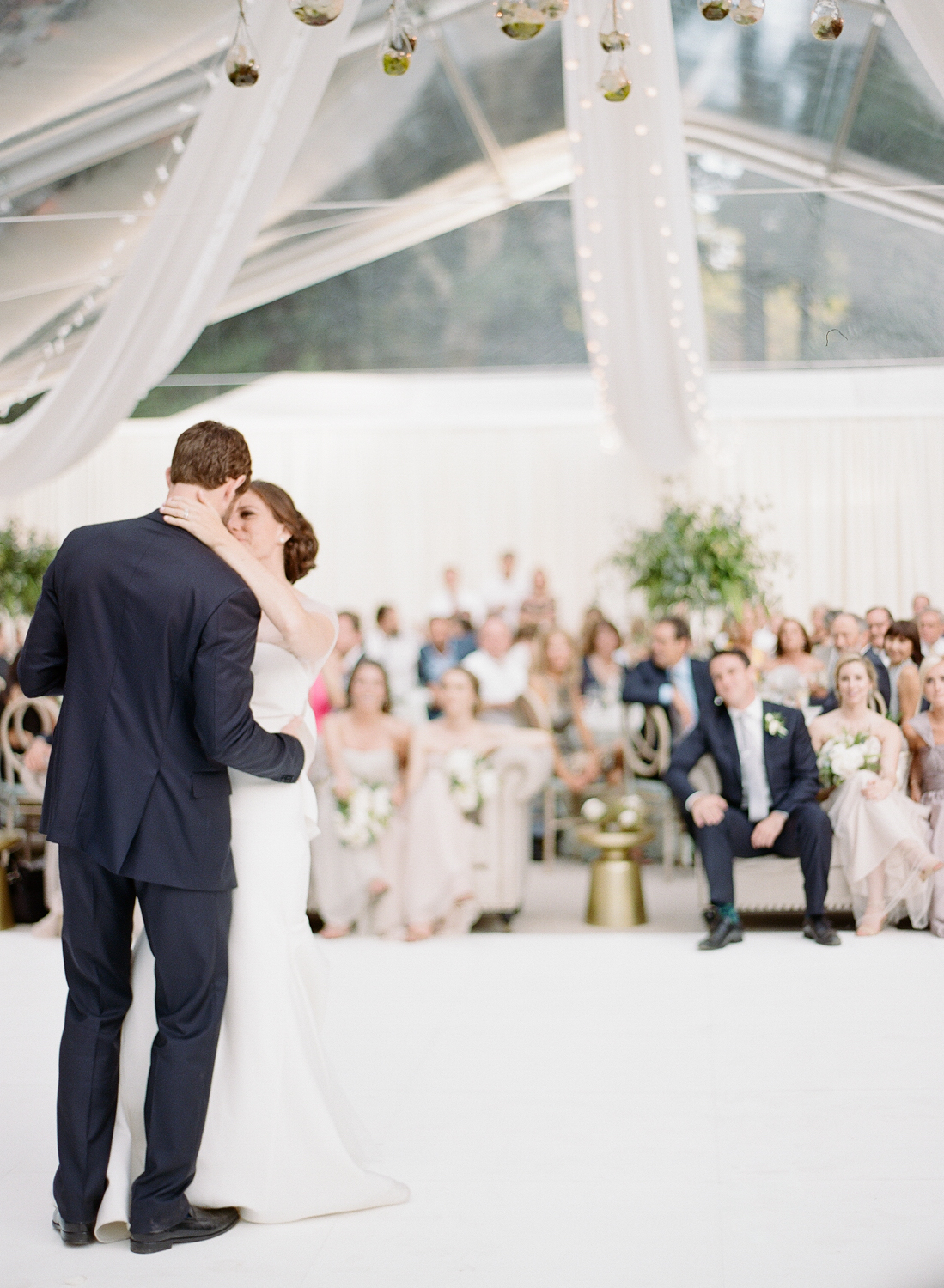 Bride in a modern Vera Wang gown and groom share their first dance; Sylvie Gil Photography