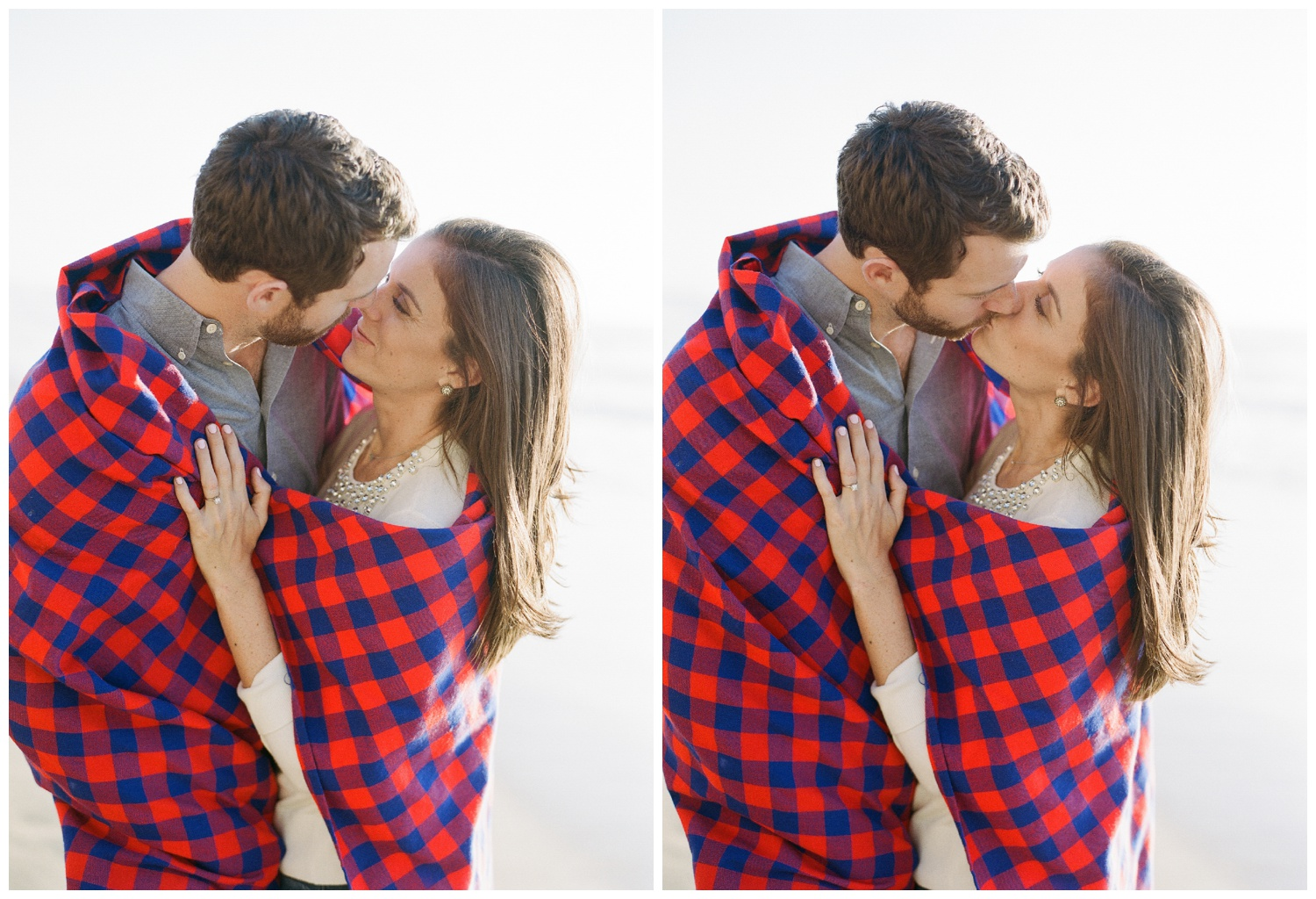 Couple wrapped in blanket during engagement session photo shoot on the beach; Sylvie Gil Photography