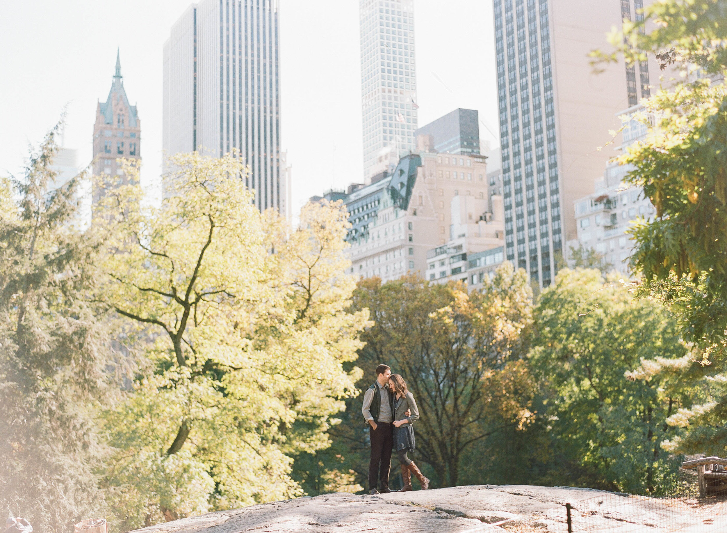 Couple shares a moment during a late summer engagement session in Central Park, New York City; Sylvie Gil Photography