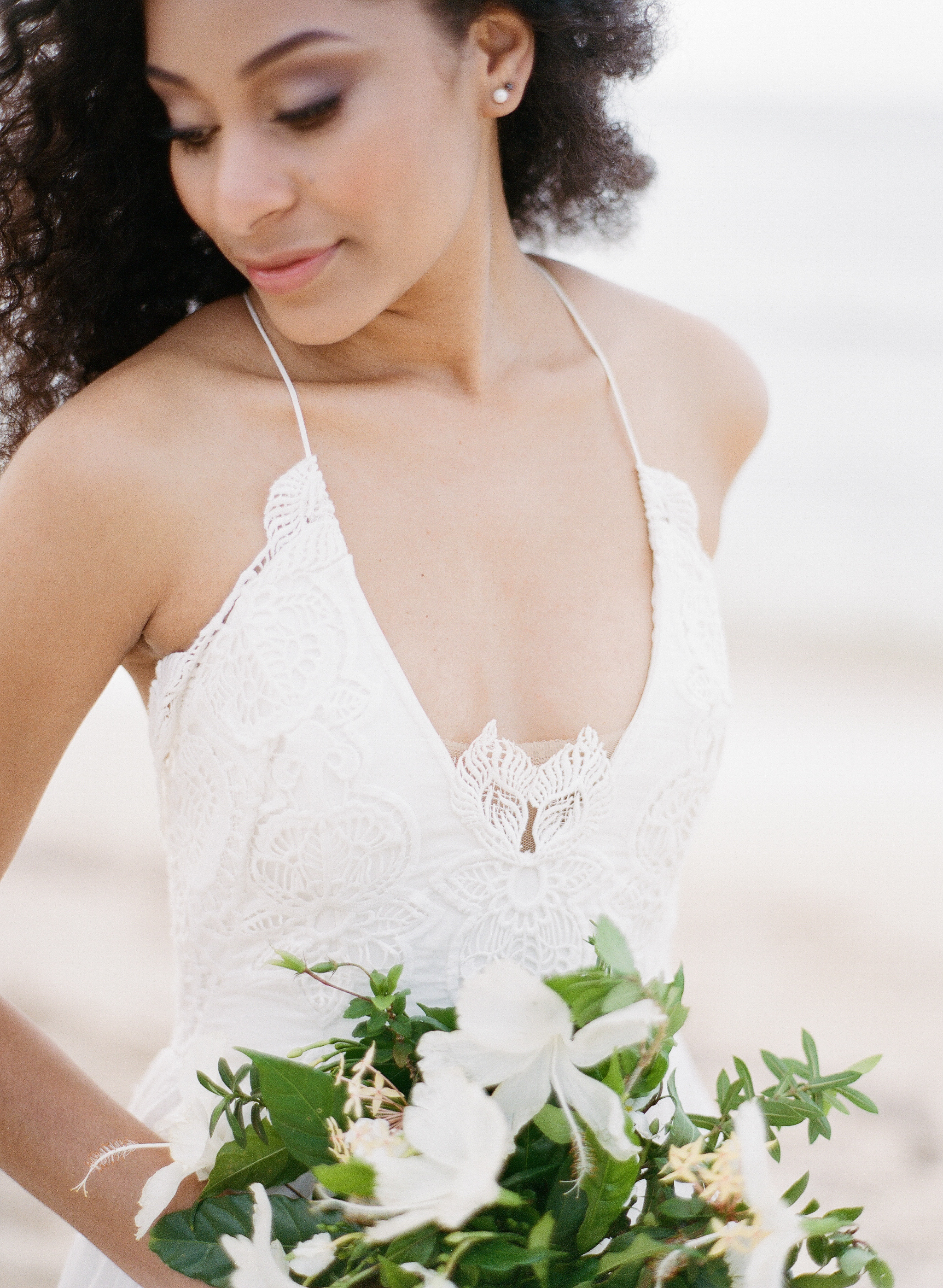 Hibiscus bouquet and floaty bride for Jamaican style shoot; Sylvie Gil Photography