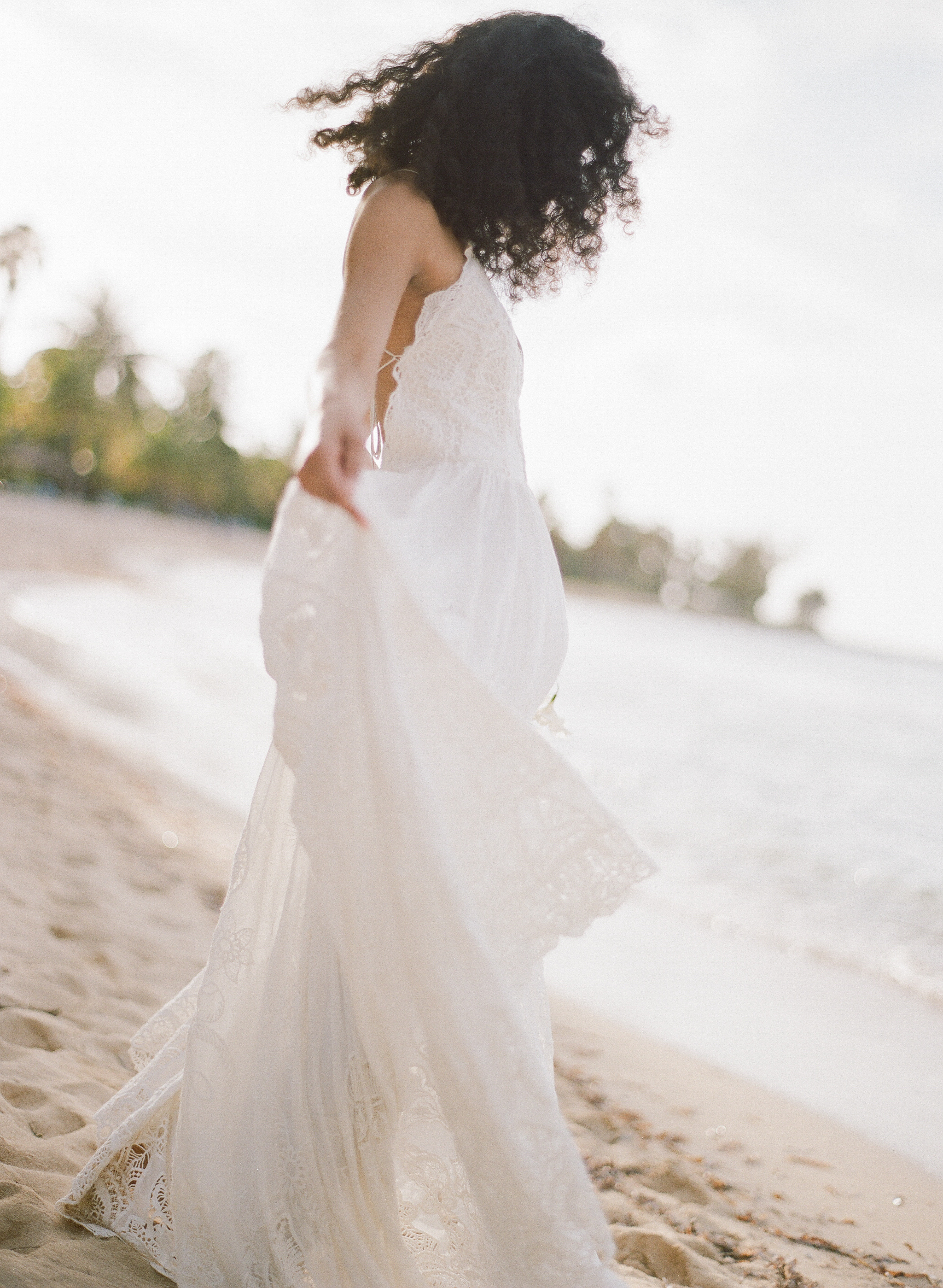 Caribbean bride spins in her flowy white gown on the beach in Jamaica; Sylvie Gil Photography