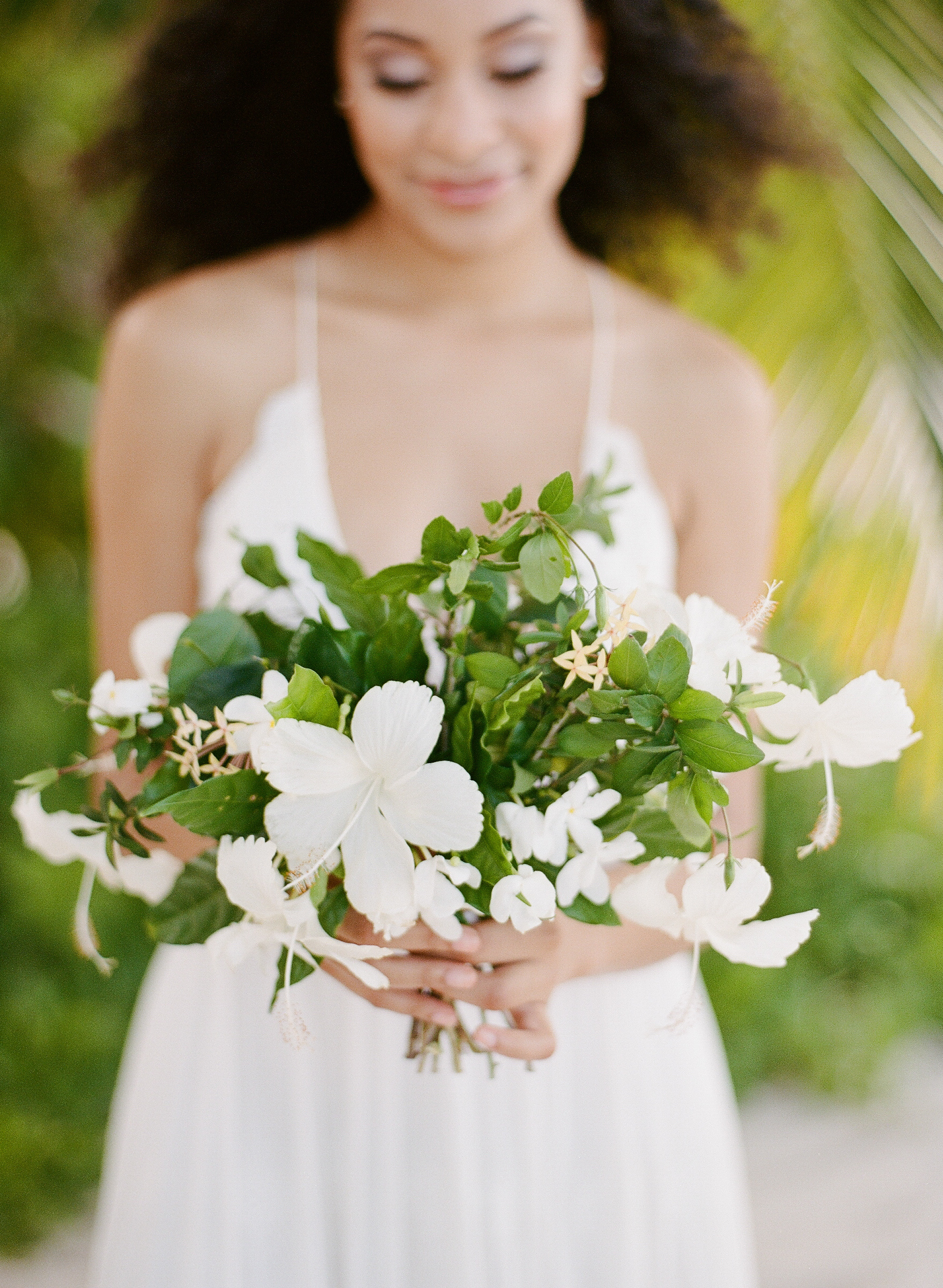 Tropical hibiscus bouquet for a beachy style shoot in Montego Bay, Jamaica; Sylvie Gil Photography