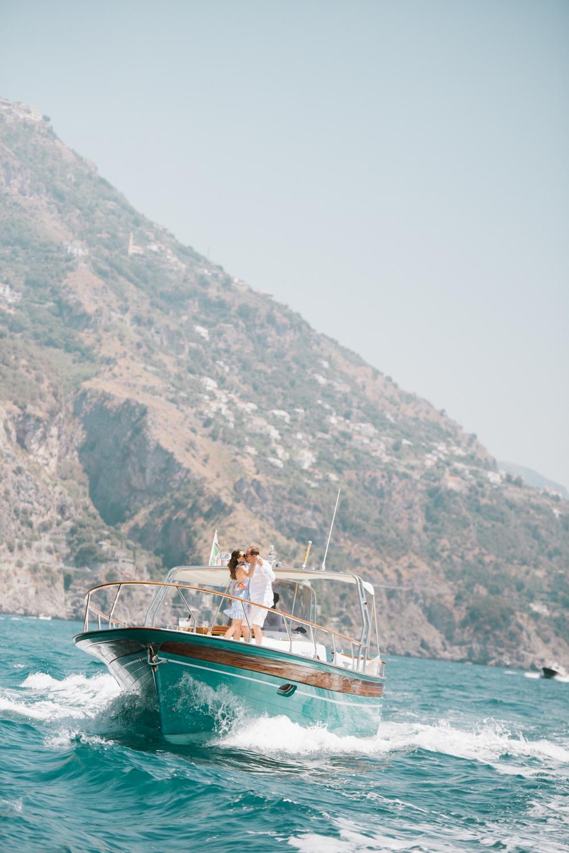 Bride and groom dance on the deck of a yacht off the Amalfi Coast; Sylvie Gil Photography