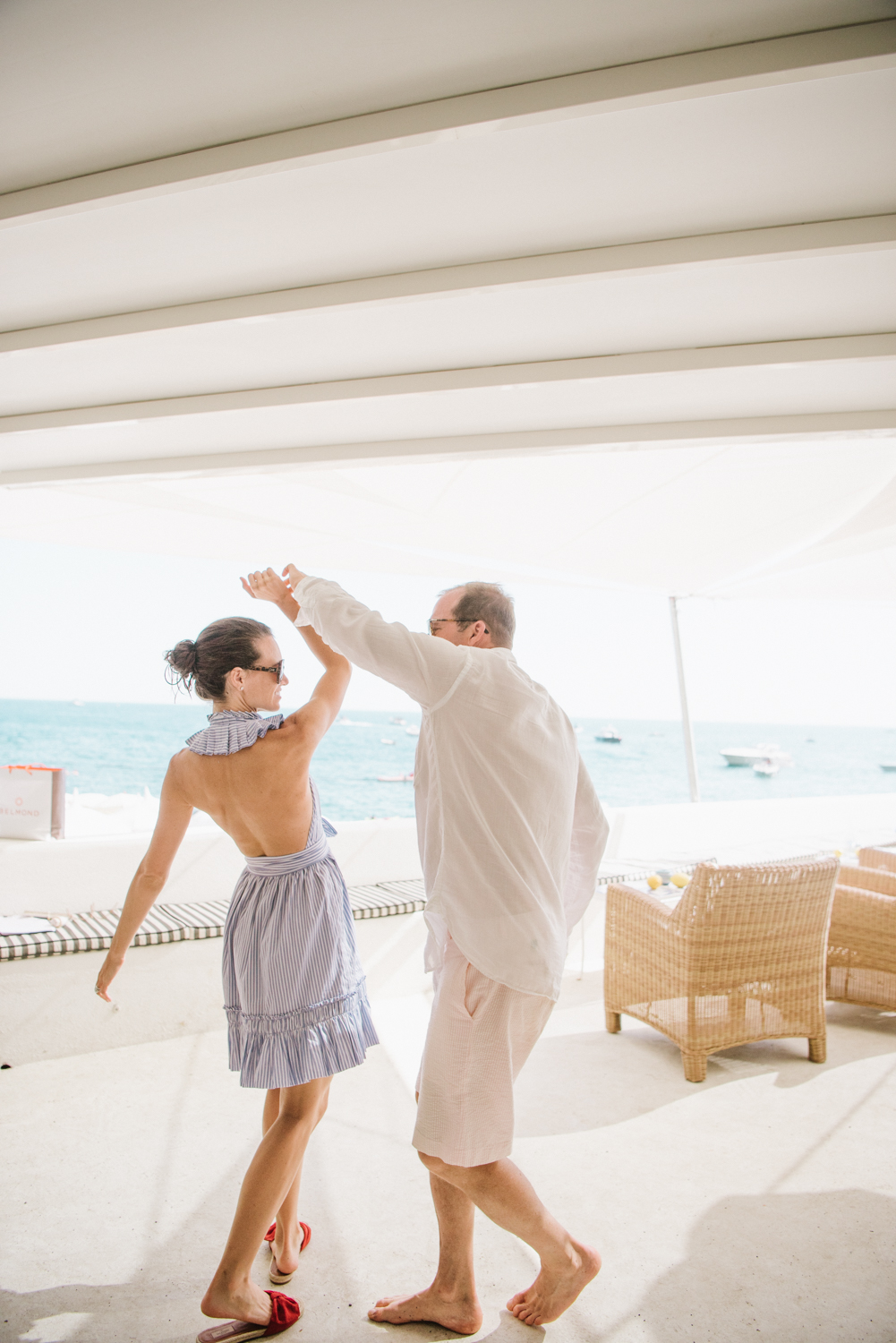 Bride and groom dance at the beach club in Positano during their wedding brunch; Sylvie Gil Photography