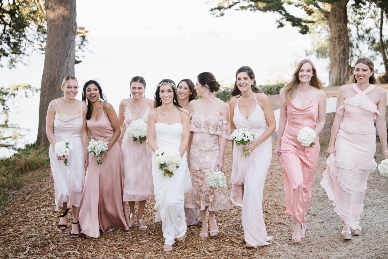 Bridesmaids walk toward the camera during a bridal party shoot; Sylvie Gil Photography