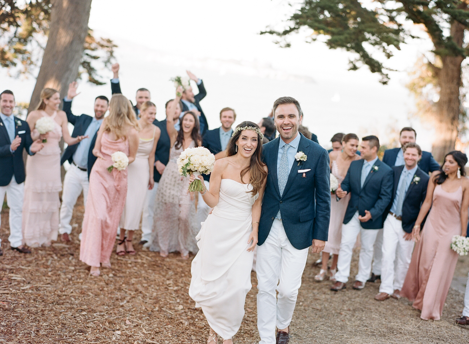 The bridal party laughs and jokes before the wedding ceremony next to the San Francisco Bay; Sylvie Gil Photography