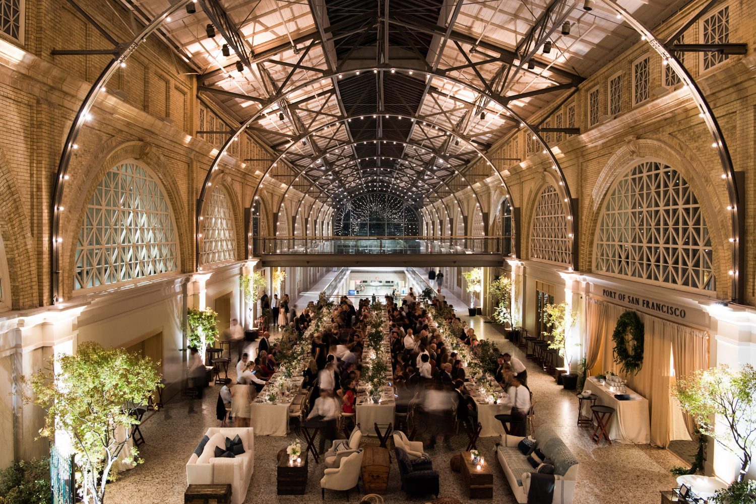 Guests enjoy the wedding reception at the Ferry Building in San Francisco; Sylvie Gil Photography