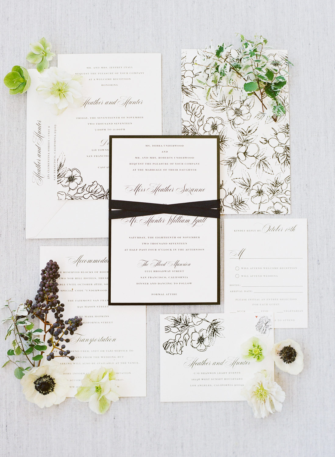 Wedding invitation suite framed with dogwoods; Sylvie Gil Photography
