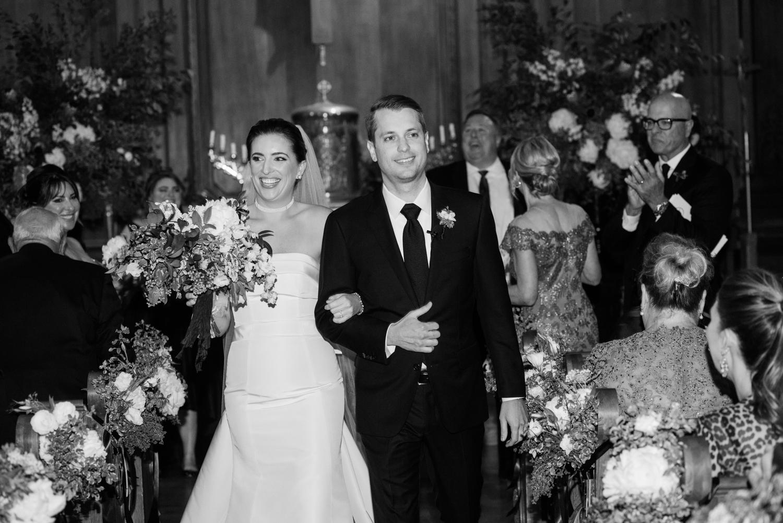 Church wedding, couple just married walks down the aisle; Sylvie Gil Photography