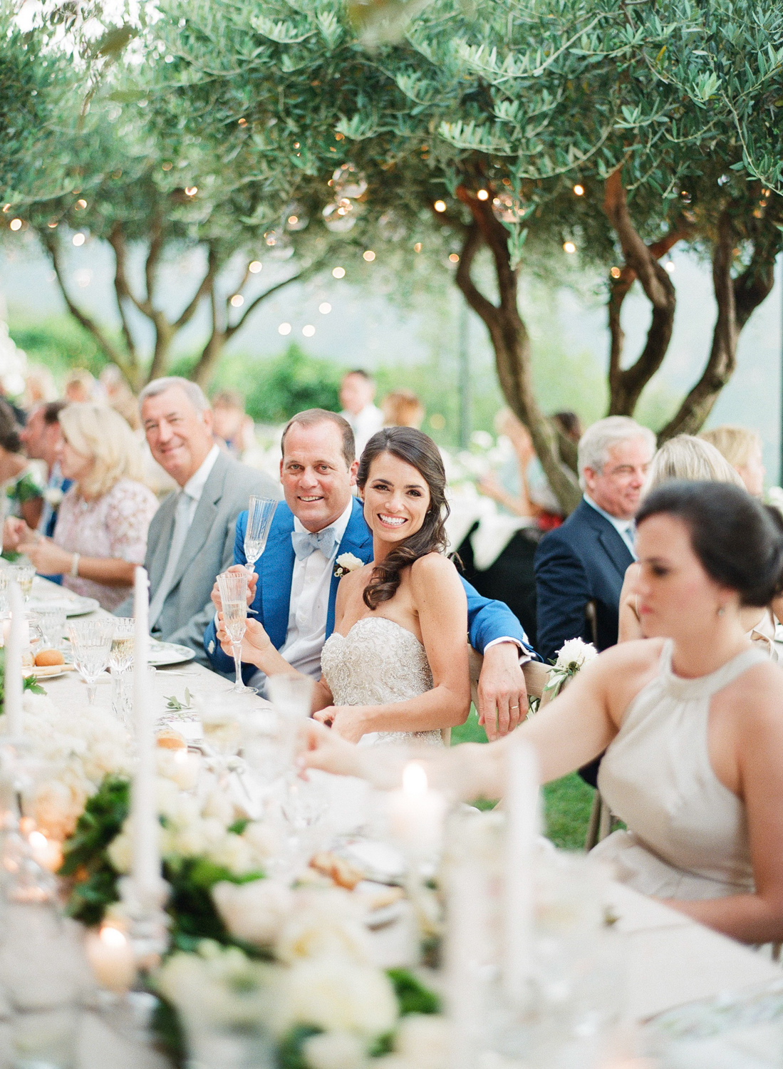 The bride toasts champagne during the Amalfi Coast wedding reception; Sylvie Gil Photography