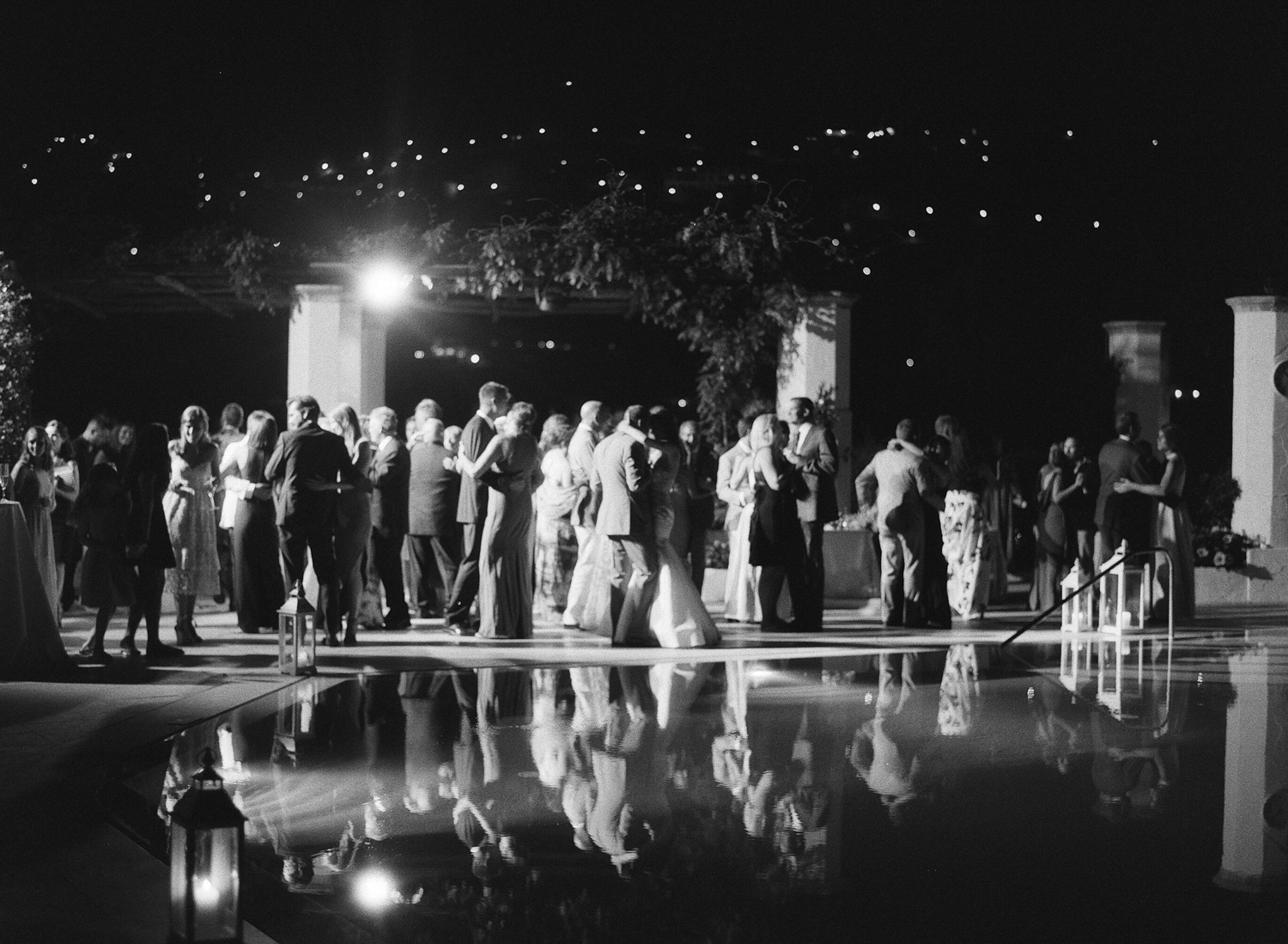 The wedding guests dance by the pool at night in Ravello, Italy; Sylvie Gil Photography