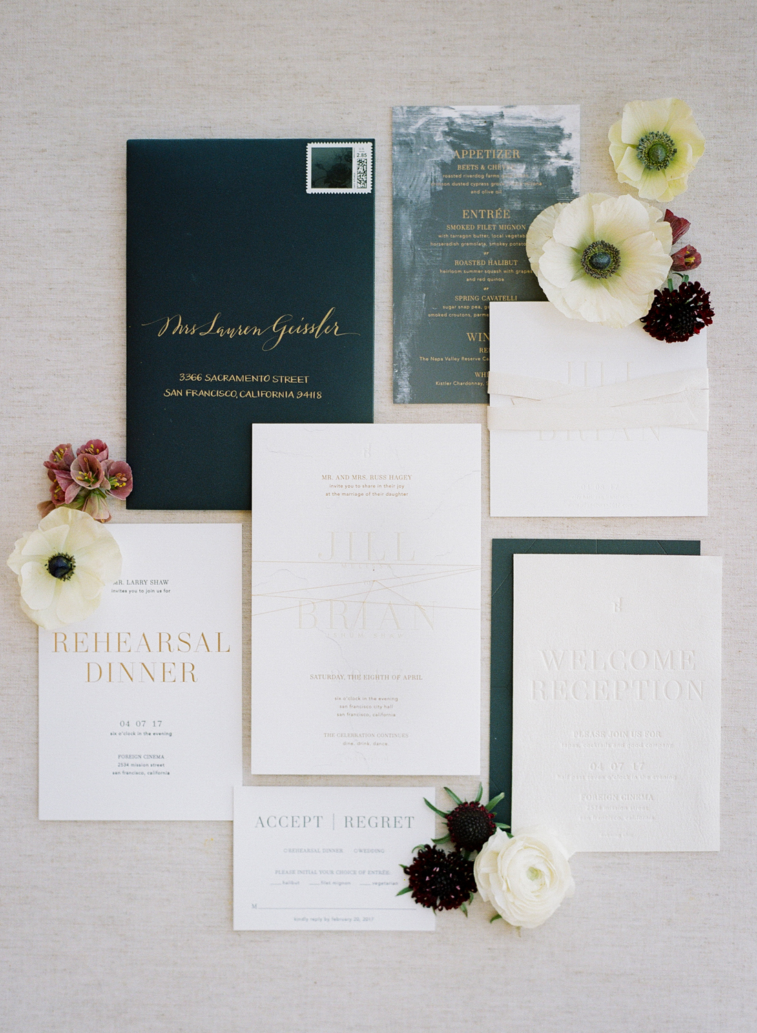 A layflat of the modern wedding invitation suit, framed by dogwoods; Sylvie Gil Photography