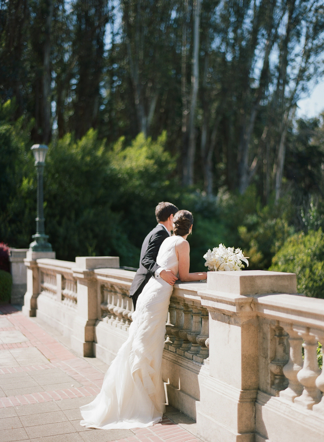 The couple looks out over the Lyon steps together before the wedding; Sylvie Gil Photography
