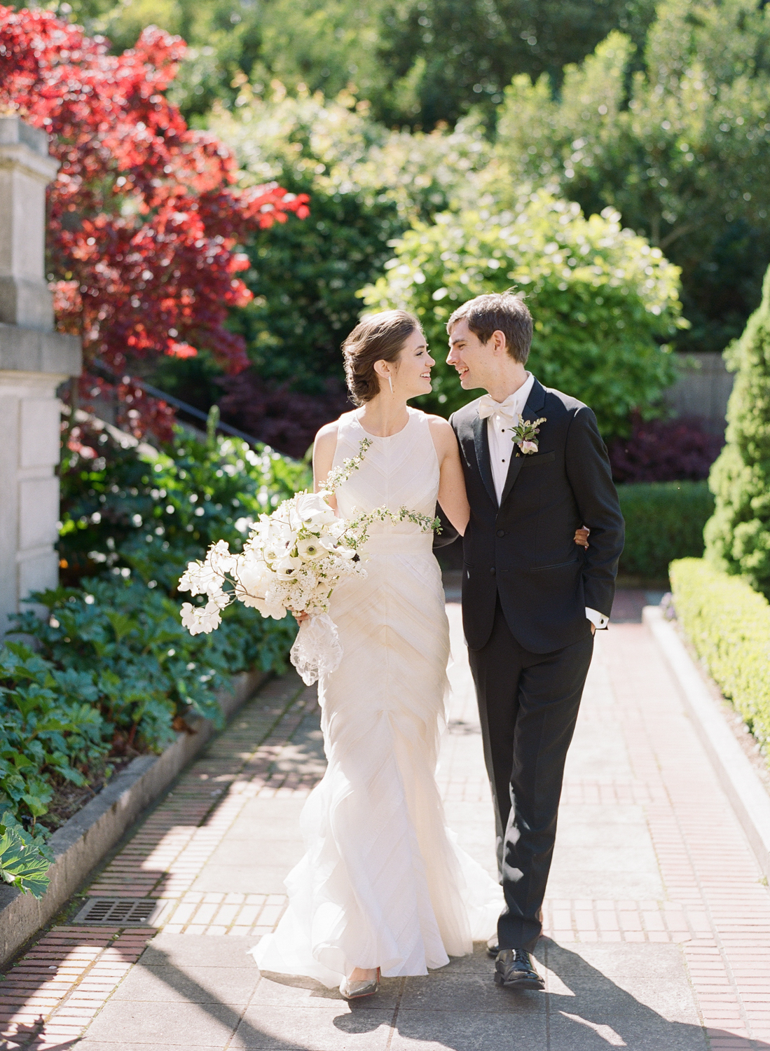 The bride and groom take a stroll together before their wedding at San Francisco City Hall; Sylvie Gil Photography