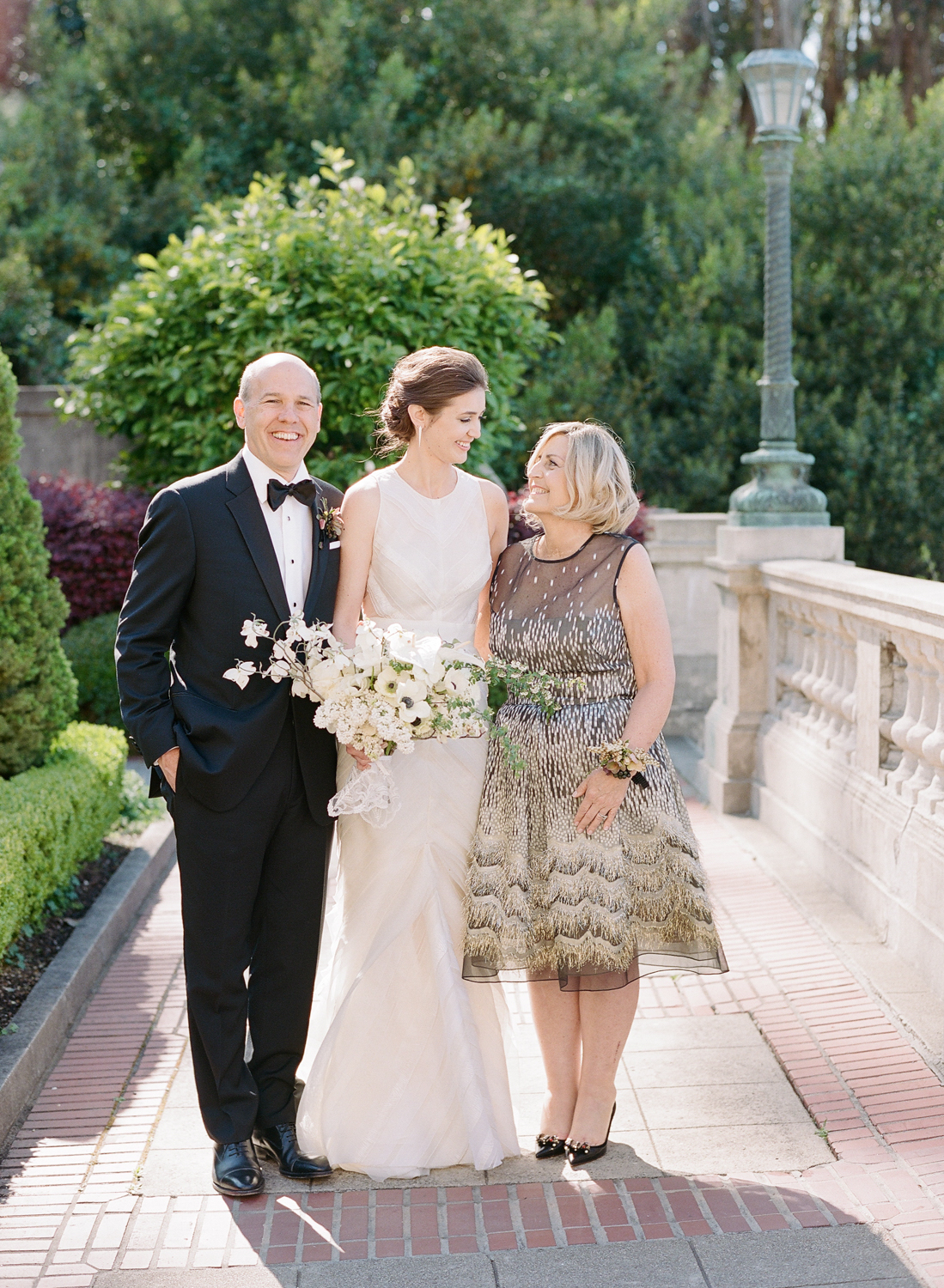 The bride and her parents on her wedding day at Lyon Steps; Sylvie Gil Photography