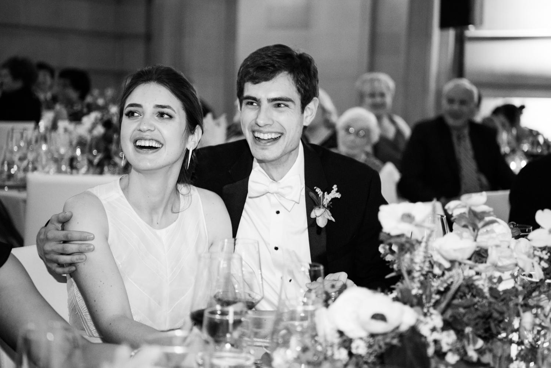 Jill & Brian share a laugh during toasts at their wedding reception at San Francisco City Hall; Sylvie Gil Photography