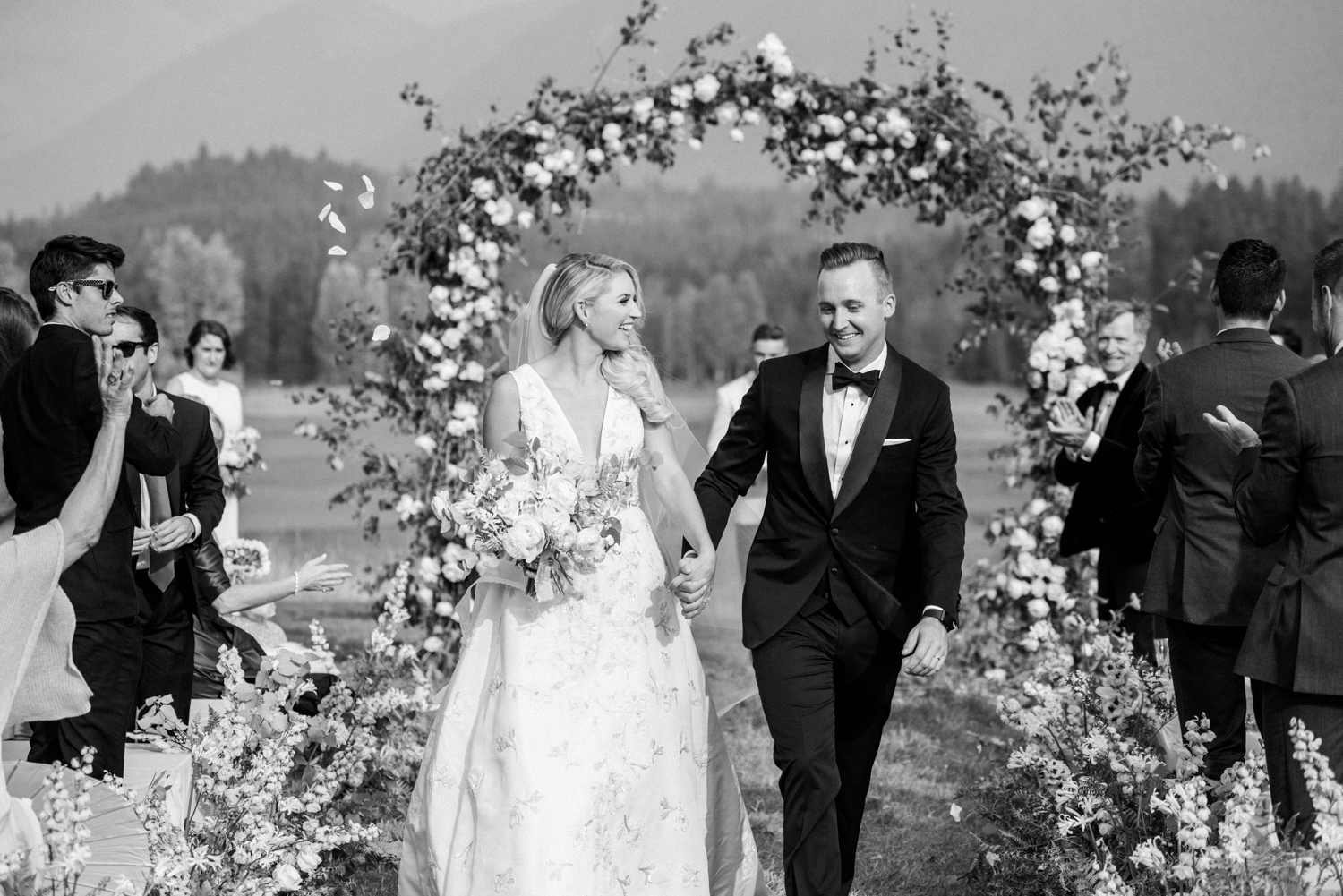 Bride and groom walk down the aisle, just married; Sylvie Gil Photography
