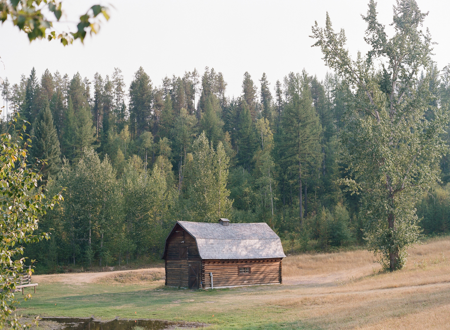 A rustic barn in Whitefish, Montana, near the ceremony space; Sylvie Gil Photography