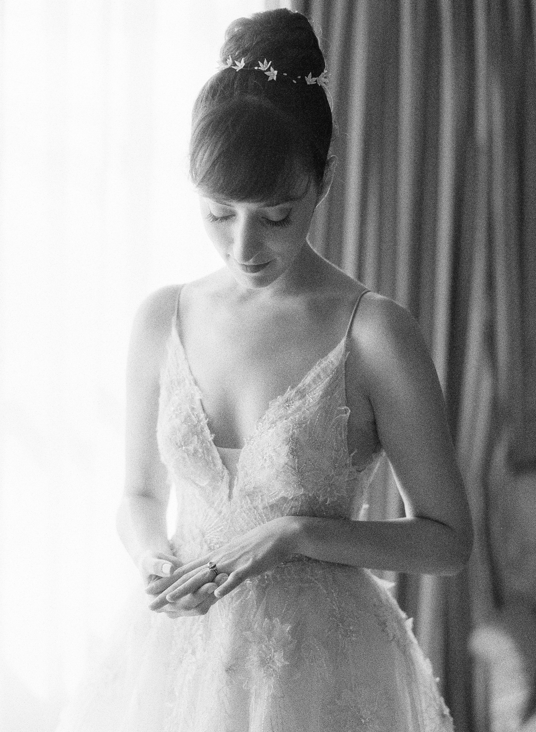 A bride looks down at her ring before the ceremony; Sylvie Gil Photography