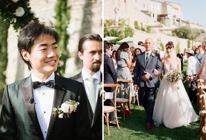 The groom looks on as his bride walks down the aisle; Sylvie Gil Photography