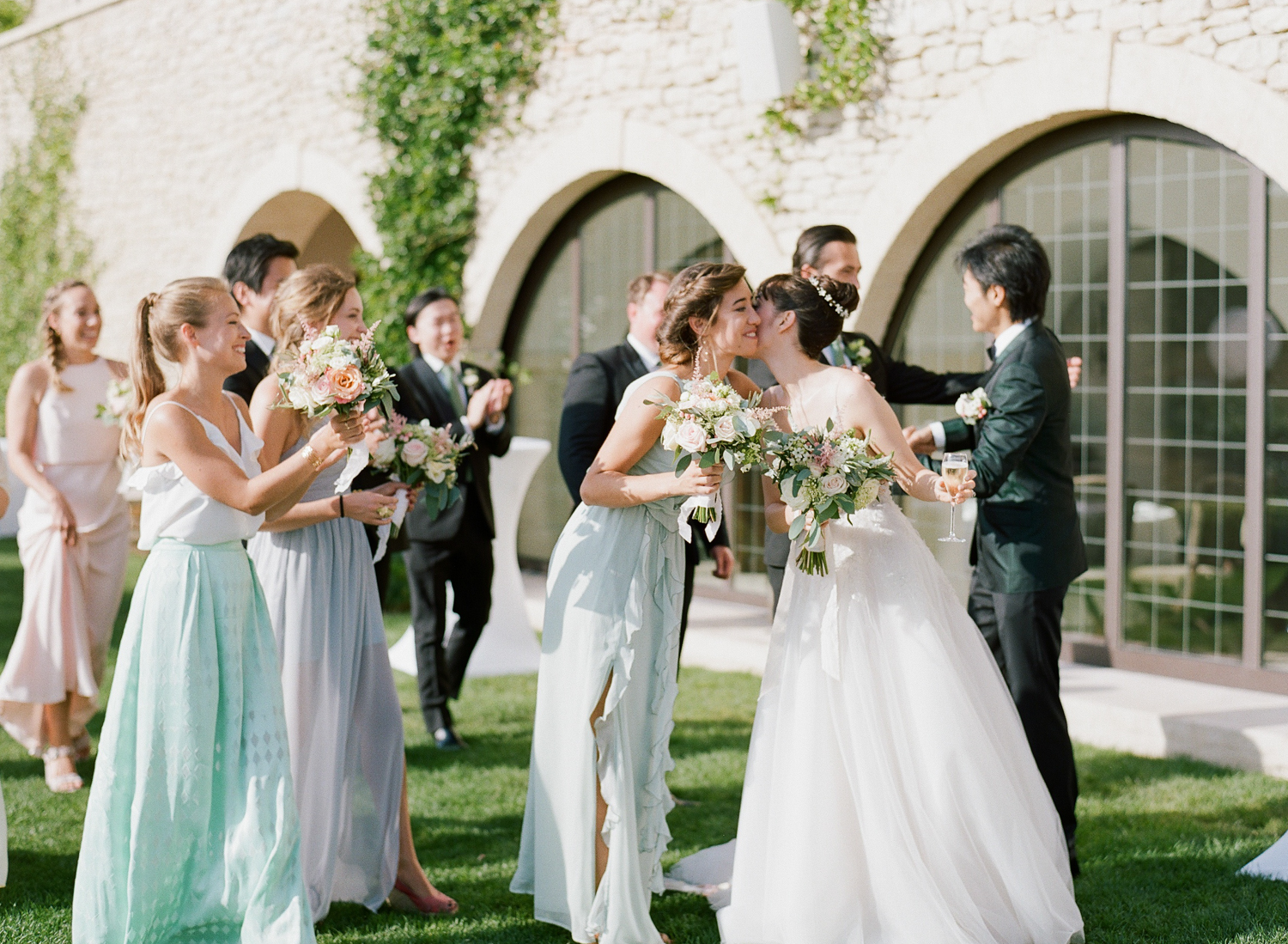The bridal party greets the bride and groom after the ceremony; Sylvie Gil Photography