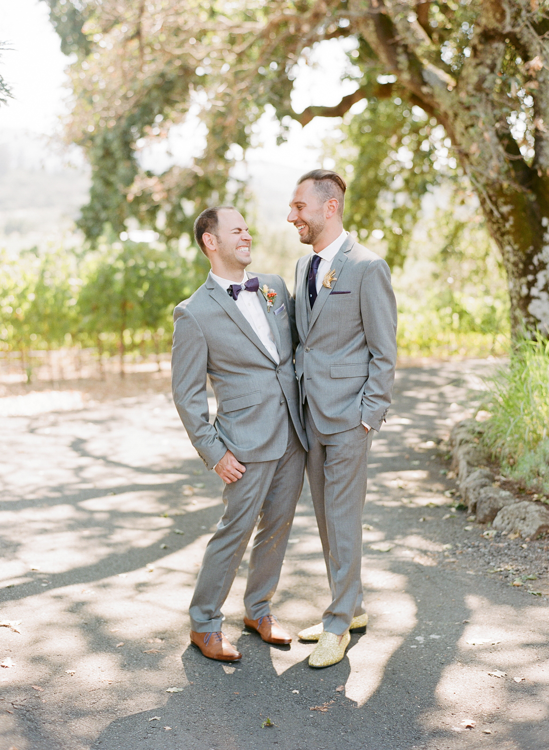 Grooms share a laugh before their Kunde Winery wedding ceremony; Sylvie Gil Photography