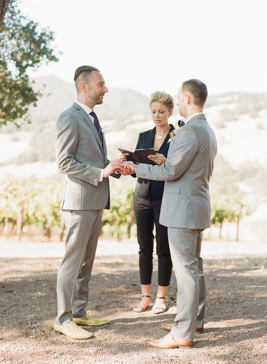 """Grooms saying """"I do"""" in the vineyards of Napa Valley; Sylvie Gil Photography"""
