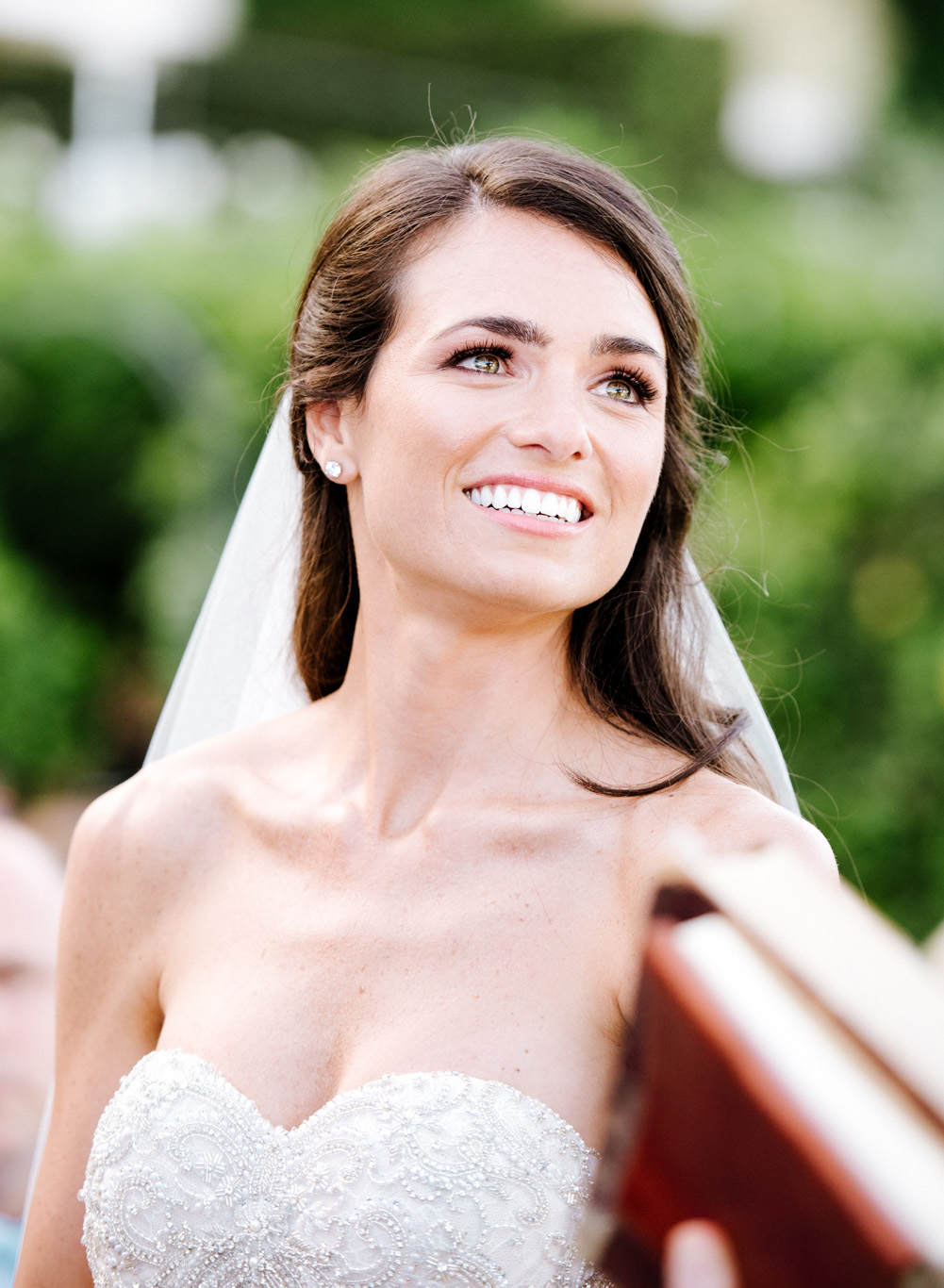 The bride tears up during the ceremony; Sylvie Gil Photography