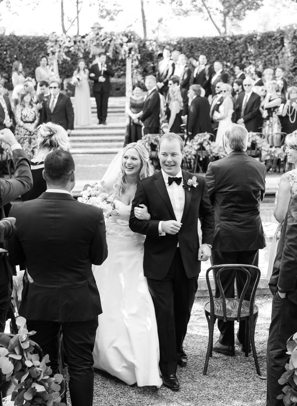 Bride and groom walk back up the aisle after their wedding at Beaulieu Gardens in St. Helena; Sylvie Gil Photography