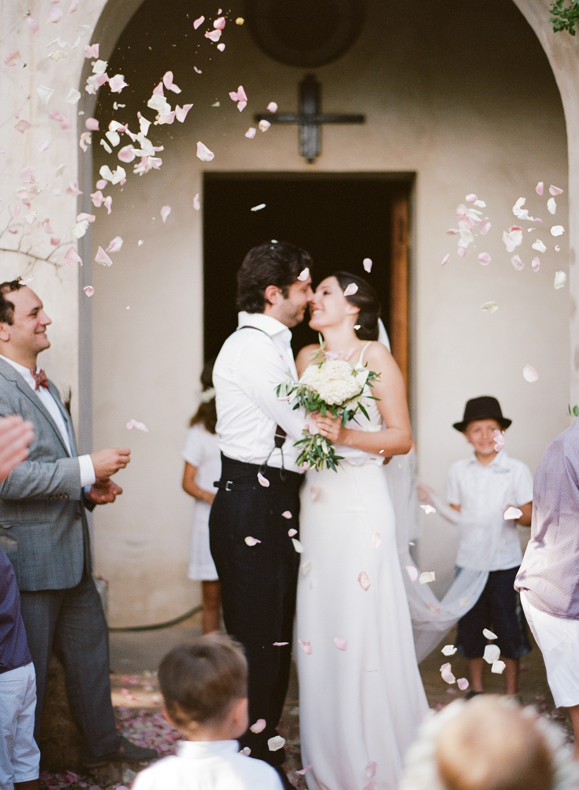 Bride and groom just married, walk out of the Provence village chapel; Sylvie Gil Photography